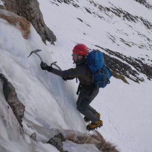 Brad on an icefall next to Red Gill